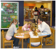 Family at play in Ellettsville Children's Room