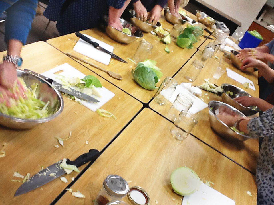 People at the Fermentation Workshop Make Starter Jars of Sauerkraut