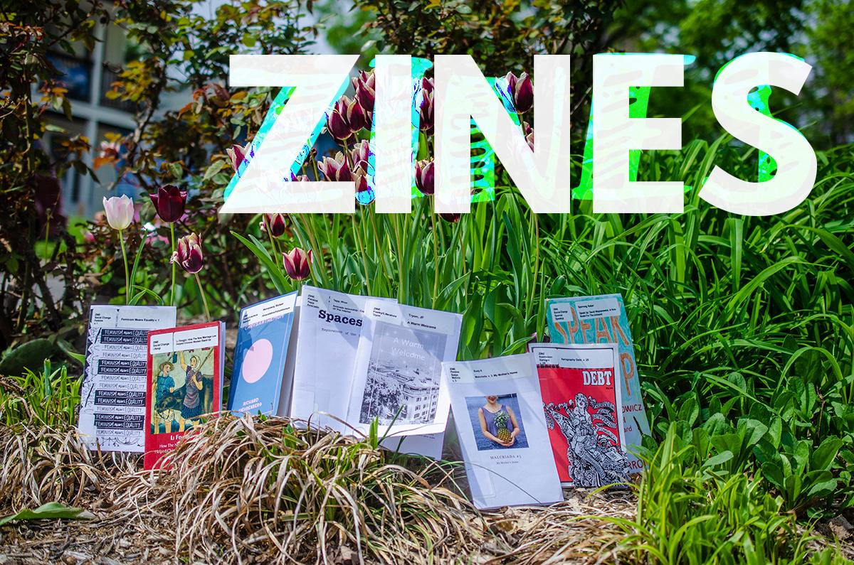 "Zines and flowers outside of the library. The title of the images says ""zines"""