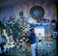 Georgia (Flaten) Shaw with mural in Children's department