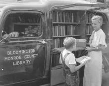 Miss Lois Henze with the Library's first bookmobile.