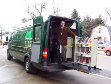 Unloading book carts from the Outreach Van.